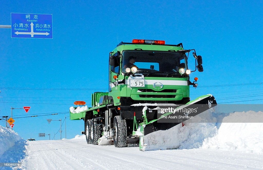 A snow removing vehicle clear the snow a day after the blizzard hit Hokkaido on March 4, 2013 in Koshimizu, Hokkaido, Japan. The death toll rises to nine after a 76-year-old woman found frozen dead.