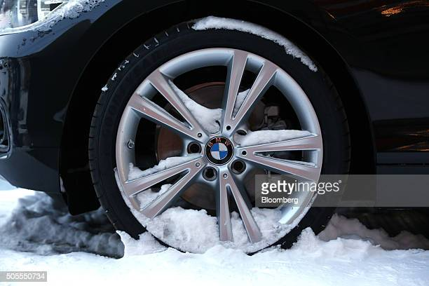 Snow rests in the wheel hub of a Bayerische Motoren Werke AG xDrive automobile on display ahead of the World Economic Forum in Davos Switzerland on...