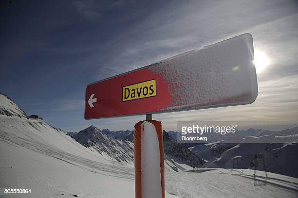 Snow rests on a sign towards Davos town on a ski slope on the Parsenn mountain in Davos Switzerland on Monday Jan 18 2015 World leaders influential...