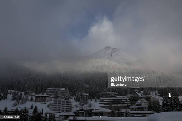 Snow rests on hotels and residential property on the opening day of the World Economic Forum in Davos Switzerland on Tuesday Jan 23 2018 World...