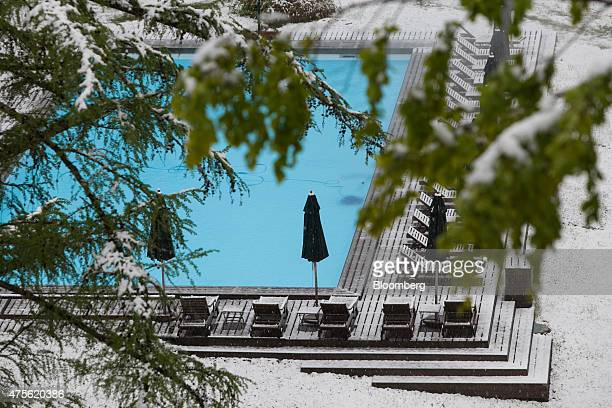 Snow rests on sun loungers around the swimming pool outside the Schloss Elmau hotel ahead of the Group of Seven nations meeting in the Bavarian Alps...