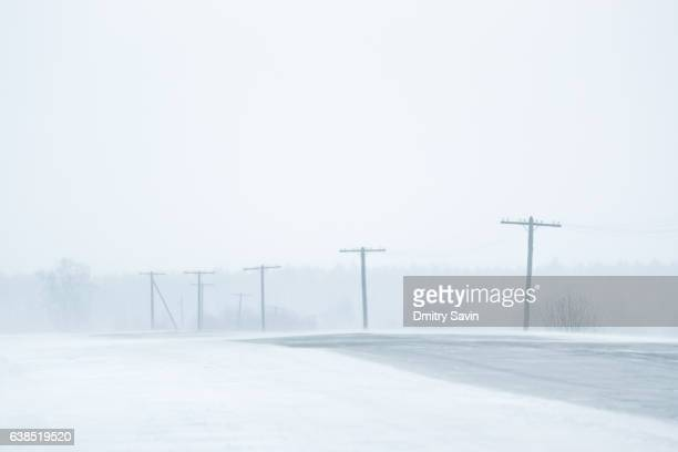 snow road in snowstorm - sleet stock photos and pictures