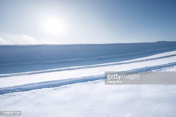 snow roads in natural wilderness - schneebedeckt stock-fotos und bilder
