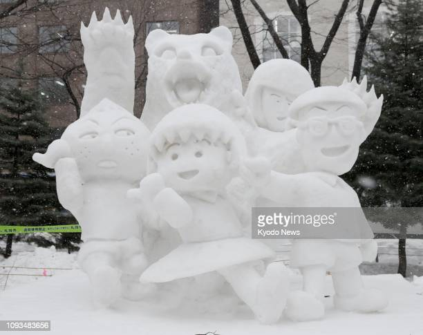 A snow sculpture of Chibi Marukochan characters is displayed at the annual Sapporo Snow Festival in Hokkaido on Feb 4 in memory of Momoko Sakura...