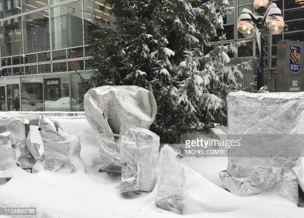 Snow sculptures for Ottawa Winterlude festival are wrapped up to protect them against the snow on February 13 2019 in Ottawa Ontario as a massive...