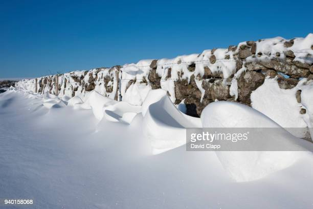 snow shapes on dartmoor, england - deep snow stock pictures, royalty-free photos & images