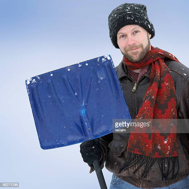 snow shoveler - snow shovel stock photos and pictures