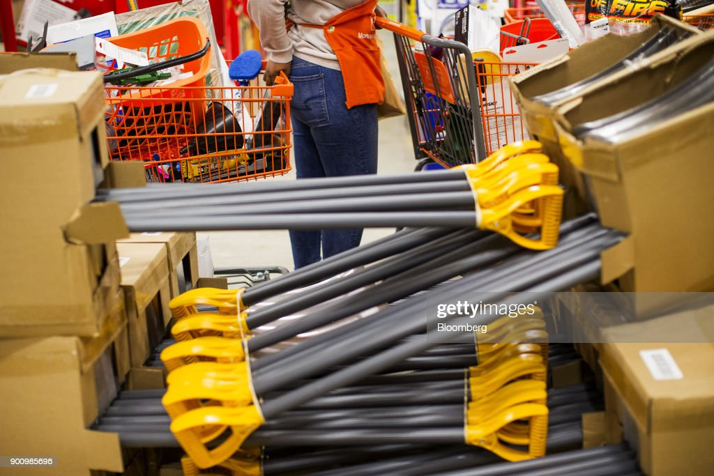 Snow shovels sit on display for sale as a worker pushes carts of supplies at a Home Depot Inc. store in Boston, Massachusetts, U.S., on Wednesday, Jan. 3, 2018. The worst winter storm of the season has already knocked out power and canceled more than 1,600 flights. Next it threatens to bring more snow, ice and cold from Florida to Nova Scotia, including New York and Boston. Photographer: Adam Glanzman/Bloomberg via Getty Images