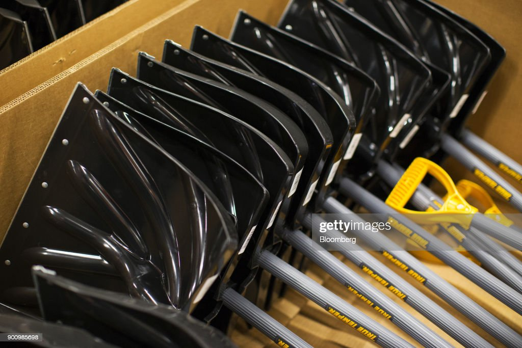 Snow shovels sit on display for sale at a Home Depot Inc. store in Boston, Massachusetts, U.S., on Wednesday, Jan. 3, 2018. The worst winter storm of the season has already knocked out power and canceled more than 1,600 flights. Next it threatens to bring more snow, ice and cold from Florida to Nova Scotia, including New York and Boston. Photographer: Adam Glanzman/Bloomberg via Getty Images