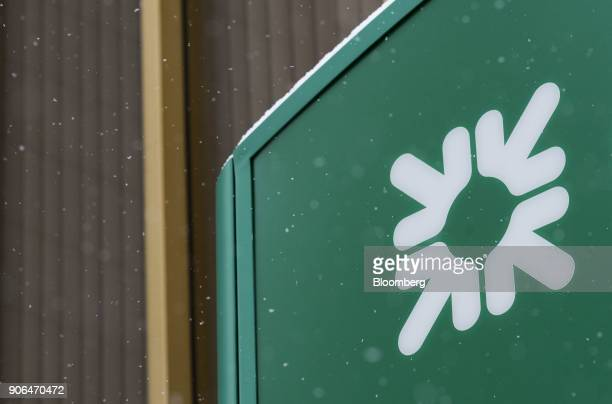 Snow sits on top of a logo displayed outside a Citizens Financial Group Inc bank branch in downtown Portsmouth Ohio US on Tuesday Jan 18 2018...