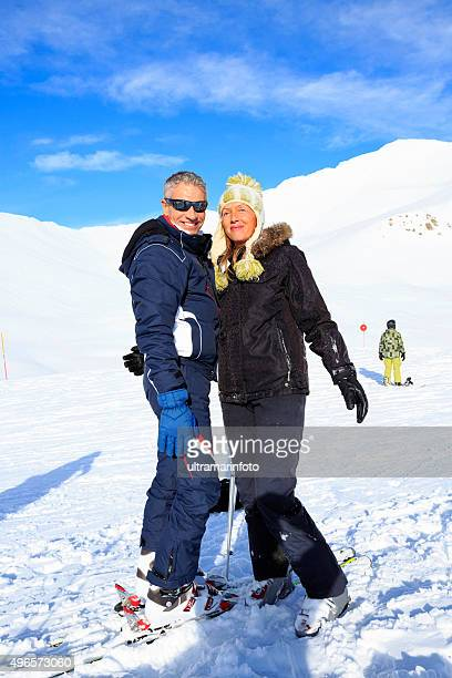 Snow skier couple enjoy at beautiful winter snow landscape