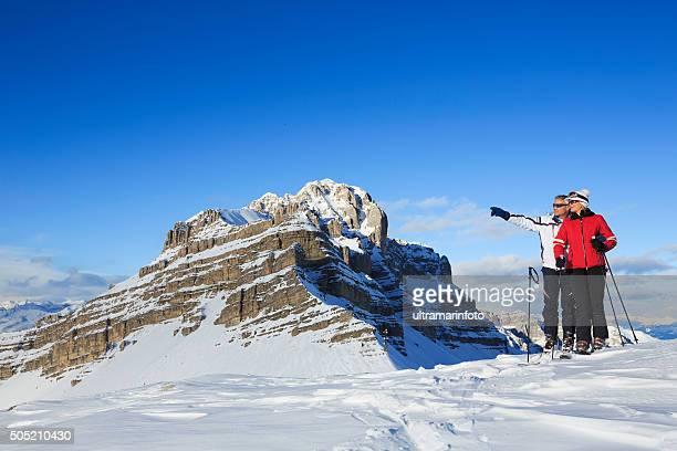 Snow Skier couple  enjoy at  view of the Dolomiti