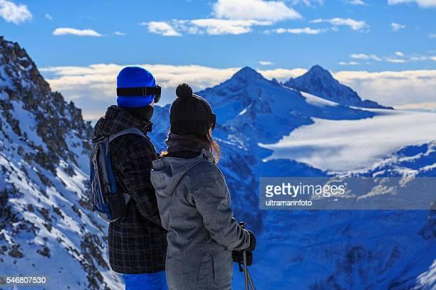 Snow skier   Skiing couple Teen boy and girl enjoying