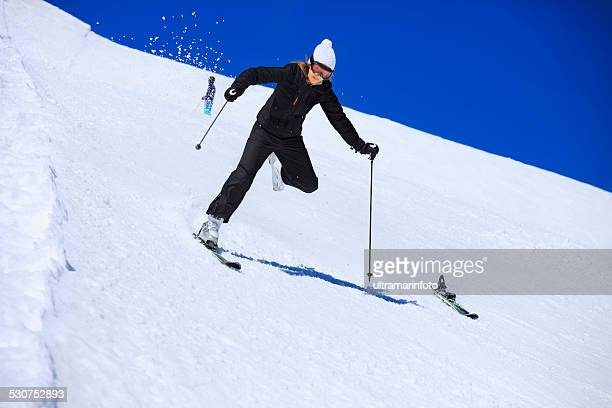 snow skiing accident  falling   woman skier skis detaches, loses,  falls - female skier stock pictures, royalty-free photos & images
