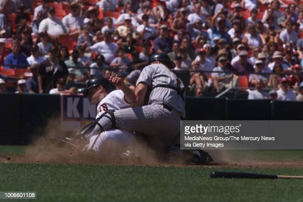 JT Snow slides in safe under the tag of Pirates catcher Joe Oliver during the 4th inning The Giants won 51