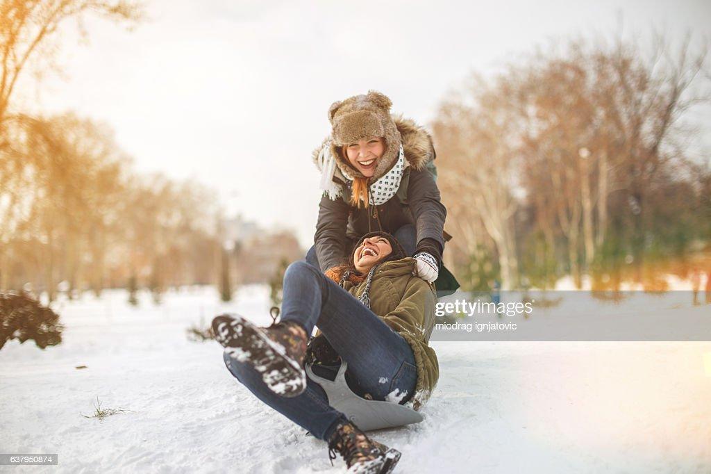 Snow sliding with girlfrend : Stock Photo