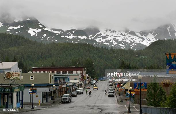 Snow sprinkes the Chugach mountain range surrounding the Main street in the town of Cordova quiet as fishermen take to the Prince William Sound for...