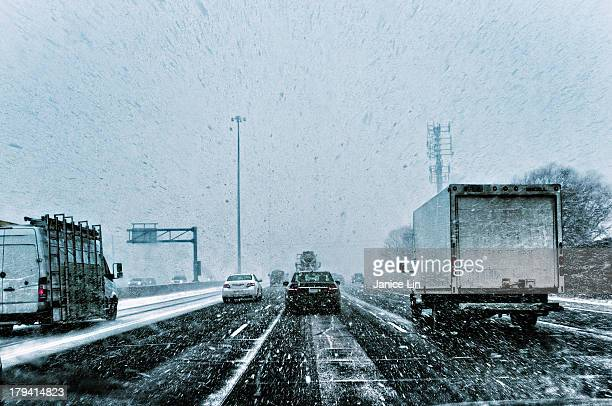 snow squall on the highway - snow squall stock photos and pictures