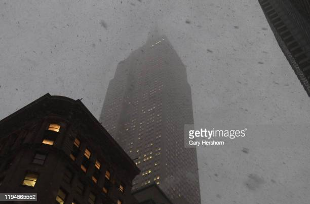 A snow squall shrouds the Empire State Building as it passes through Manhattan on December 18 in New York City