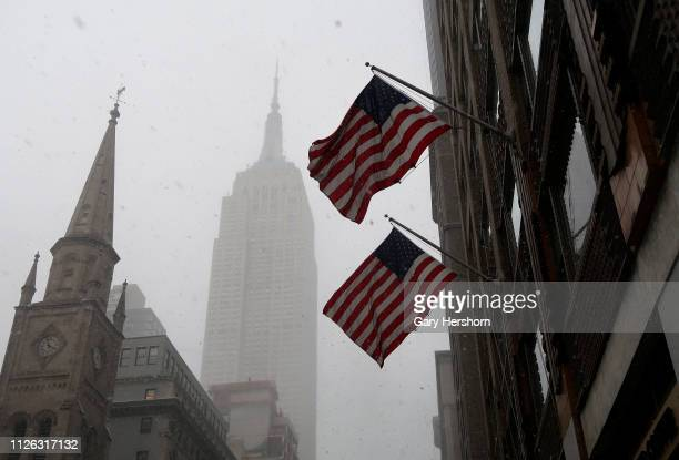 A snow squall shrouds the Empire State Building on January 30 2019 in New York City Extremely cold temperatures are predicted for New York City in...