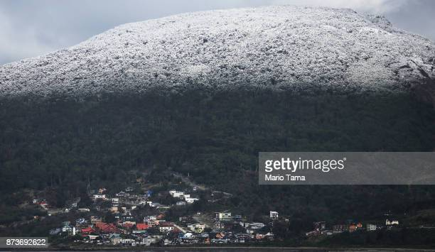 Snow stands above a separated section of the city on November 4 2017 in Ushuaia Argentina Ushuaia is situated along the southern edge of Tierra del...