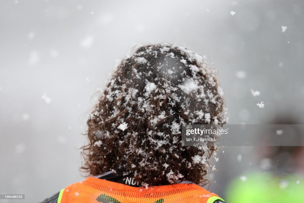 Snow sticks to Fabricio Coloccini's hair during a Newcastle United training session at the Little Benton Training Ground on January 14, 2013 in Newcastle upon Tyne, England.