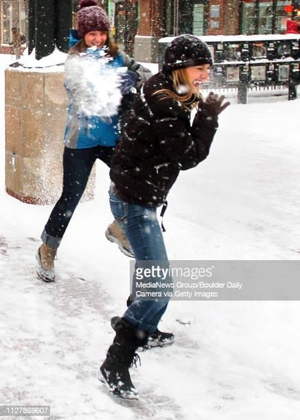 Snow Storm125Adrianna Baraco left throws snow at Nina Duerst along the Pearl Street Mall on Thursday
