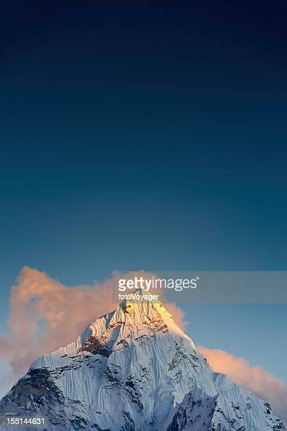 Snow summit sunset golden peak blue sky Himalayas Nepal