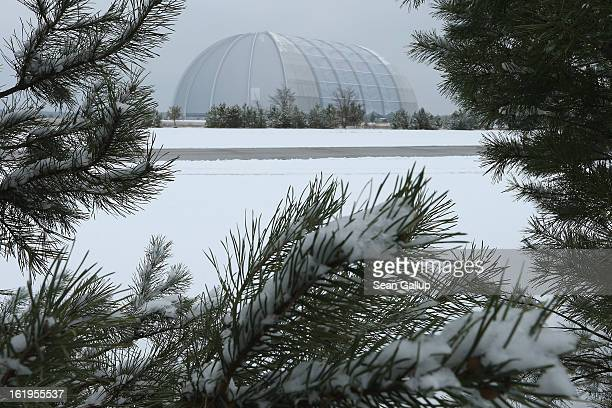 Snow surrounds the giant hangar that houses the Tropical Islands indoor resort on February 13 2013 in Krausnick Germany Located on the site of a...