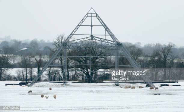 Snow surrounds the skeleton structure of the Pyramid Stage at the site of the Glastonbury Festival site at Worthy Farm in Pilton near Glastonbury on...