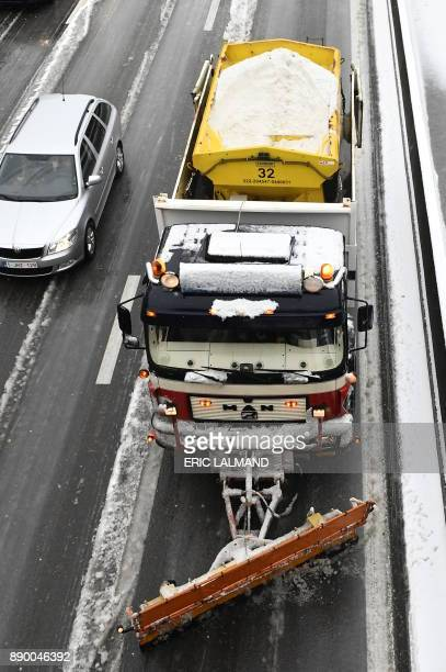 A snow truck clears and spreads salt on the E40 highway in Sterrebeek as cold temperatures sweep across Belgium on December 11 2017 Belga / ERIC...