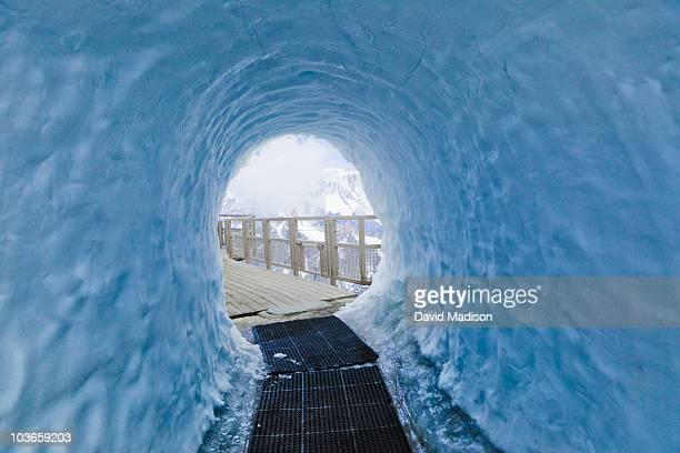 snow tunnel at aiguille du midi. - aiguille de midi stock photos and pictures