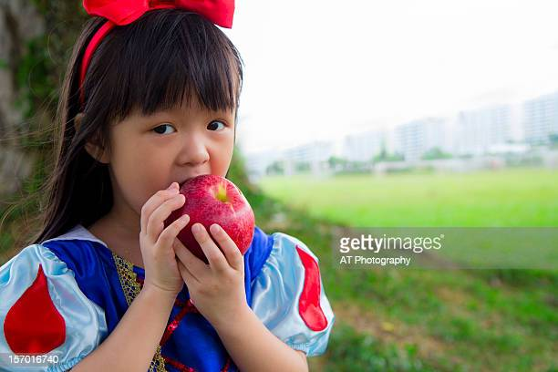 snow white and the apple - snow white stock photos and pictures