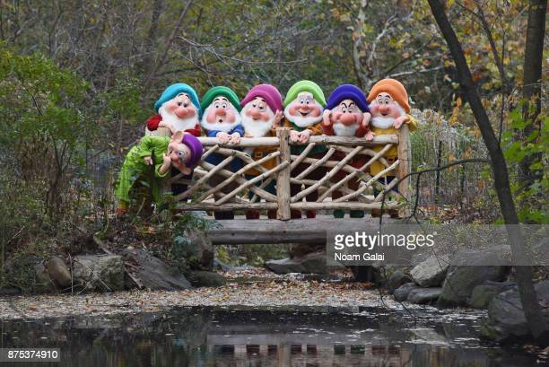 Snow White's Seven Dwarfs exploring The Loch in Central Park on November 17 2017 in New York City