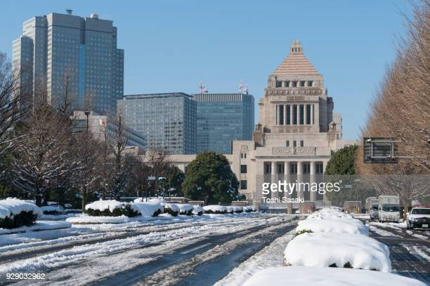 Snow wraps up The National Diet of Japan Building in Nagatacho district and many tire tracks appear on the snowy road at Chiyoda-ku Tokyo Japan – January. 23 2018.