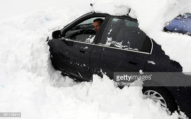 SNOW18After parking his car in Gennesse yesterday and car pooling to Loveland Ski Area Kurt Bendele try to get his car out of the spot where he...