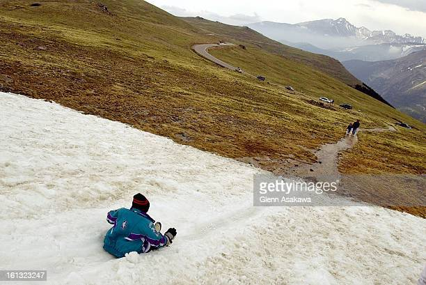 SNOW6/19/20016yearold Nicholas Smith of Indianapolis IN slides down a snowfield along Trail Ridge Road in Rocky Mountain National Park Tuesday It was...