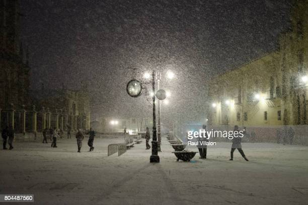 snowball fight at night - christmas scenes stock photos and pictures