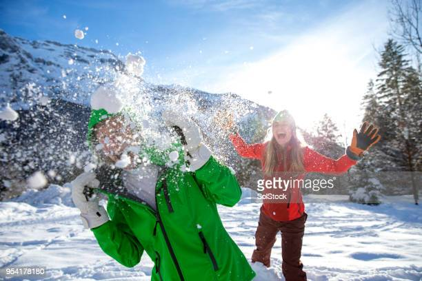 snowball fight on a ski holiday - france strike stock pictures, royalty-free photos & images
