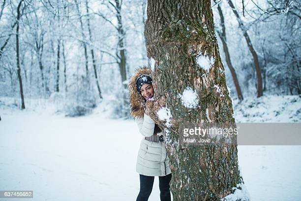 snowball fight - parka coat stock photos and pictures