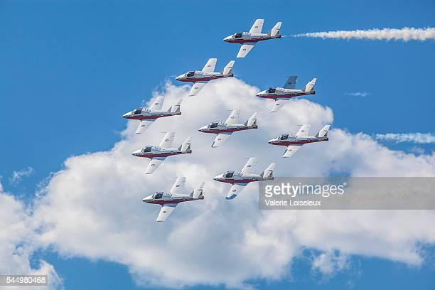 snowbirds in blue sky and clouds - canadian snowbird stock pictures, royalty-free photos & images
