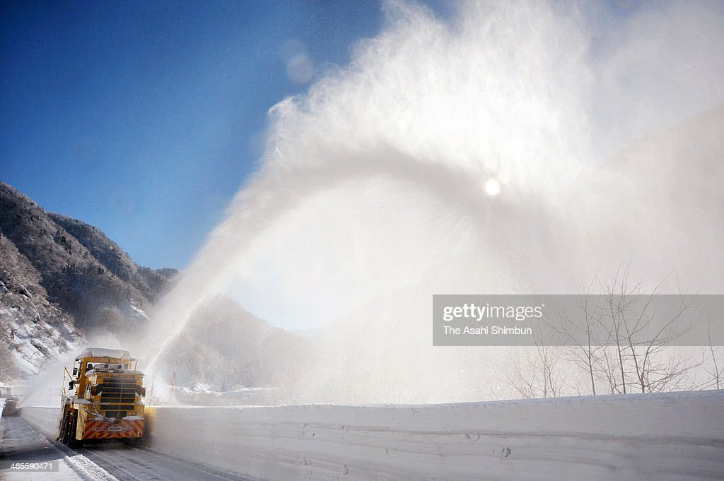 A snowblower discharge snow outside the road during the snow removal operation at the Tateyama-Kurobe Alpine Route on January 27, 2014 in Tateyama, Toyama, Japan. The road, connecting Toyama and Nagano prefectures, is closed during winter due to the heavy snow.