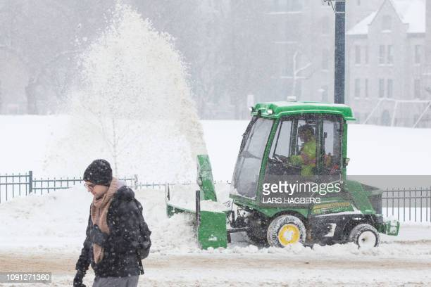 A snowblower is used on a sidewalk in Kingston Ontario on January 30 2019 In Canada the icy temperatures stretching from Manitoba in the western...