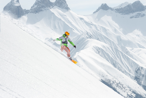 Snowboard rider gliding on the slope - gettyimageskorea