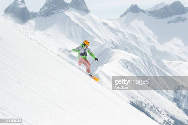 snowboard rider gliding on the slope - downhill skiing stock pictures, royalty-free photos & images