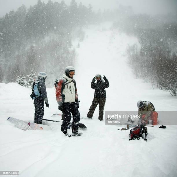 Snowboard Team on Snowy Mountain