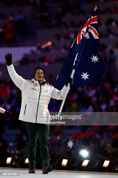 Snowboarder Alex Pullin of the Australia Olympic team carries his country's flag during the Opening Ceremony of the Sochi 2014 Winter Olympics at...