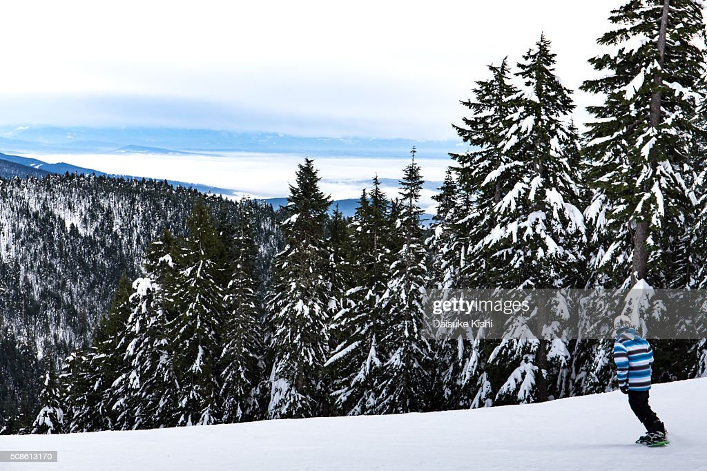 A Snowboarder and the view from Grouse Mountain, Vancouver : Stock Photo