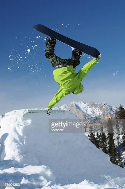 Snowboarder at handstand