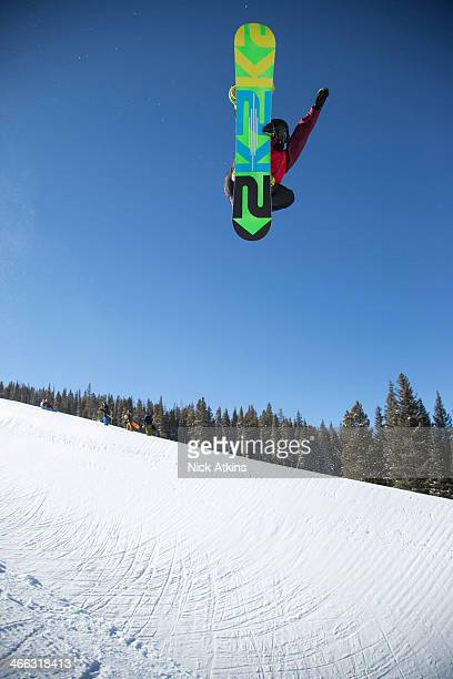 Snowboarder Ben Kilner of Team GB doing a huge frontside grab in the half pipe at Copper mountain on December 20 2012 in Colorado